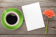 Coffee cup, blank paper and gerbera flower Royalty Free Stock Photo