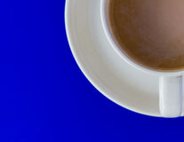 Coffee cup on blue background Royalty Free Stock Photography