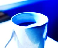 Coffee cup on blue background Stock Photo