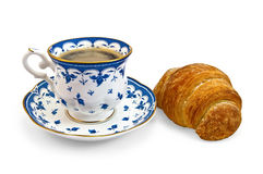 Coffee in a cup with a blue pattern and croissant Stock Image