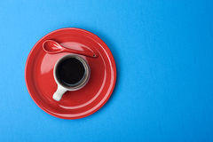 Coffee cup on blue table Stock Photos