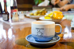 Coffee cup. Blue coffee cup on a wood table for breakfast Royalty Free Stock Photography