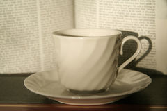 Coffee cup and book Stock Photos