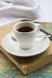 Coffee cup on book Stock Images