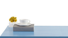 coffee cup and book on the blue wooden table stock images