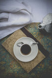 Coffee cup on book, coffee maker Stock Images