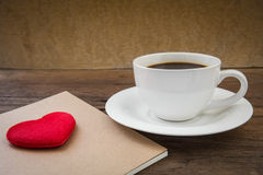 Coffee cup and book with heart shape Stock Photo