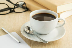Coffee cup and book on table Royalty Free Stock Photography