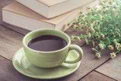Coffee cup and book on wooden table, vintage style Royalty Free Stock Photography