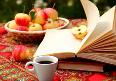 Coffee. A cup of coffee with books and apples Stock Image