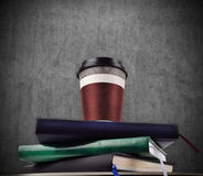 Coffee cup on books Stock Photography