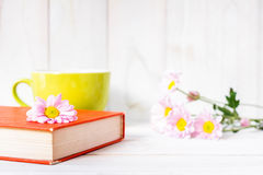 Coffee cup and books or journal with flowers. Royalty Free Stock Photography