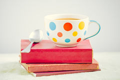 Coffee cup on the books Royalty Free Stock Photography