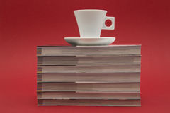 Coffee cup and books Stock Images
