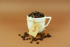 Coffee cup with a bow coffee beans and dollar sign. Coffee cup with a bow coffee, beans and a dollar sign Stock Images