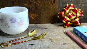 Coffee cup and bow on table Stock Photo