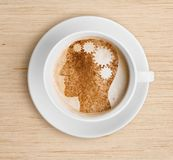 Coffee cup with brain on foam. Refreshing concept. royalty free stock photos