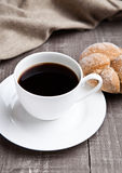 Coffee cup with bread roll for breakfast morning Royalty Free Stock Images
