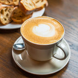 Coffee cup and bred Stock Images