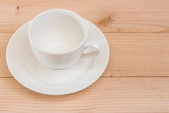 Coffee cup on the brown backgroud. White coffee cup on the brown background royalty free stock image