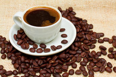 Coffee Cup and  Brown Beans Stock Image