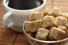 Coffee cup and brown cane sugar Stock Image