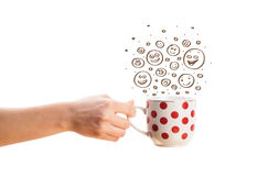 Coffee-cup with brown hand drawn happy smiley faces Royalty Free Stock Photos