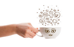 Coffee-cup with brown hand drawn happy smiley faces Stock Photography