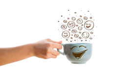 Coffee-cup with brown hand drawn happy smiley faces Stock Images