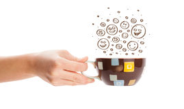 Coffee-cup with brown hand drawn happy smiley faces Royalty Free Stock Photo