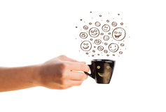 Coffee-cup with brown hand drawn happy smiley faces Royalty Free Stock Photography