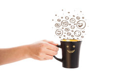 Coffee-cup with brown hand drawn happy smiley faces Royalty Free Stock Image