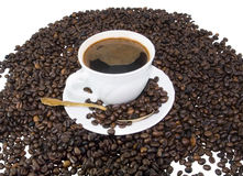 Coffee cup on brown roasted beans Stock Image