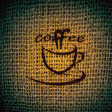Coffee. Cup of coffee on burlap (sacking) texture Stock Image