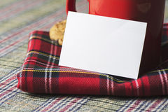 Coffee cup and business card, plaid blanket red Royalty Free Stock Image