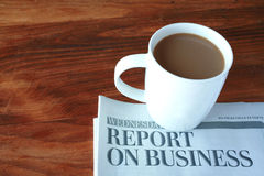 Coffee cup and business section of newspaper. Royalty Free Stock Photos