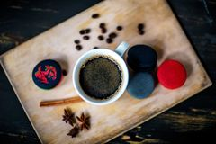Coffee. A cup of cafe latte and coffee beans stock photography