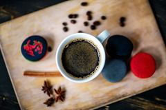 Coffee. A cup of cafe latte and coffee beans stock photos