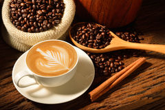 Coffee. A cup of cafe latte and coffee beans Stock Image