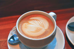 Coffee cup on cafe table Stock Image