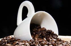 Coffee cup with caffee beans Royalty Free Stock Photo