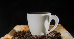 Coffee cup with caffee drops Stock Photos