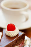 Coffee cup and cake Stock Images