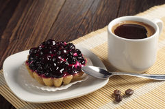 Coffee cup and cake with black currants Stock Image