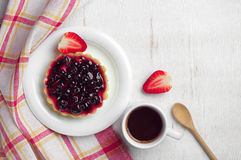 Coffee cup, cake with black currants and strawberry. On table, top view Stock Photos