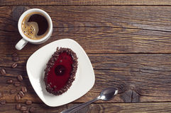 Coffee cup and cake with cherry jelly Stock Photos