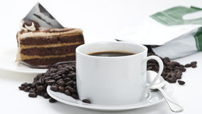 Coffee cup and Cake with Coffee Beans. On white background royalty free stock photo