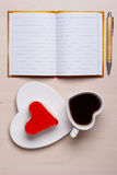 Coffee cup cake in heart form and notebook Royalty Free Stock Photos
