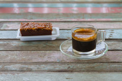 Coffee cup and cake on old wooden table for breakfast Stock Images