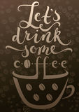 Coffee cup and calligraphy above it Royalty Free Stock Photo